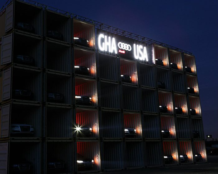 The Best Shipping Container Structures of 2014 audi shipping container scoreboard A8 headlights designboom 06 700x560