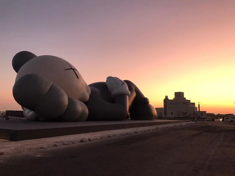 KAWS Debuts Art Sculpture That Overlooks Doha's Skyline art sculpture KAWS Debuts Art Sculpture That Overlooks Doha's Skyline KAWS Debuts Sculpture That Overlooks Dohas Skyline 7
