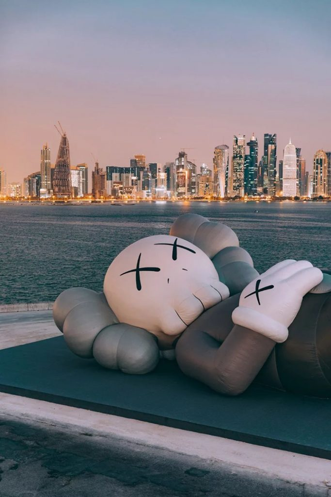 KAWS Debuts Art Sculpture That Overlooks Doha's Skyline art sculpture KAWS Debuts Art Sculpture That Overlooks Doha's Skyline KAWS Debuts Sculpture That Overlooks Dohas Skyline 8 683x1024