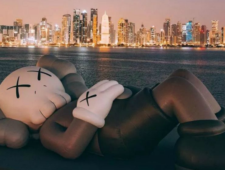art sculpture KAWS Debuts Art Sculpture That Overlooks Doha's Skyline KAWS Debuts Sculpture That Overlooks Dohas Skyline feature 740x560